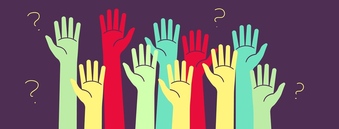 Raised hands wanting to ask questions