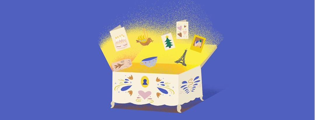 A memory chest opens with bright yellow light and birthday cards, Christmas ornaments, plane tickets, an Eiffel tower, and a photograph.