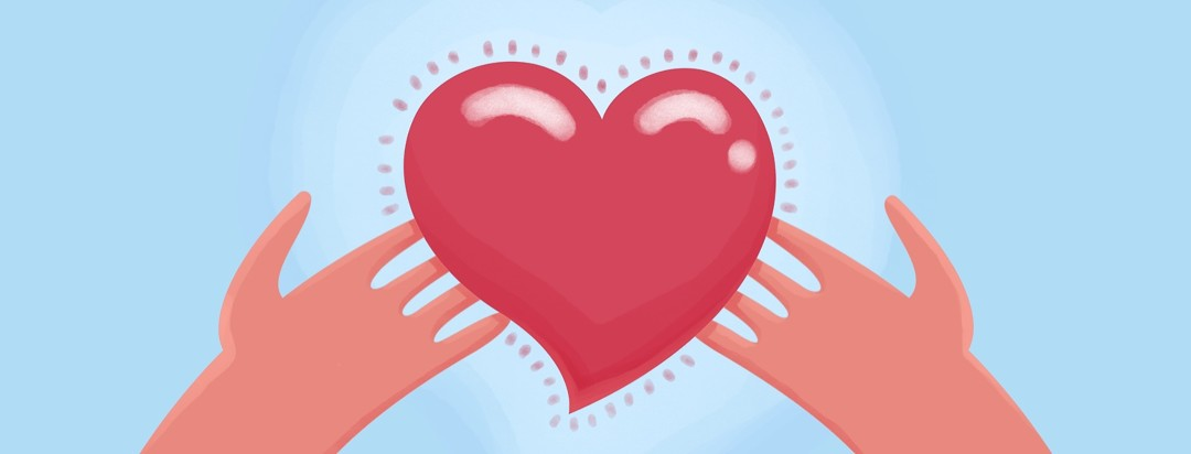 Two hands support a heart that is radiating love