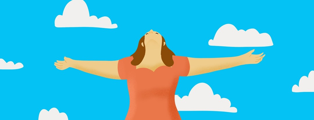 A woman looks at the sky with her arms outstretched