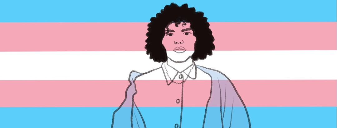 A trans woman stands in front of the trans flag
