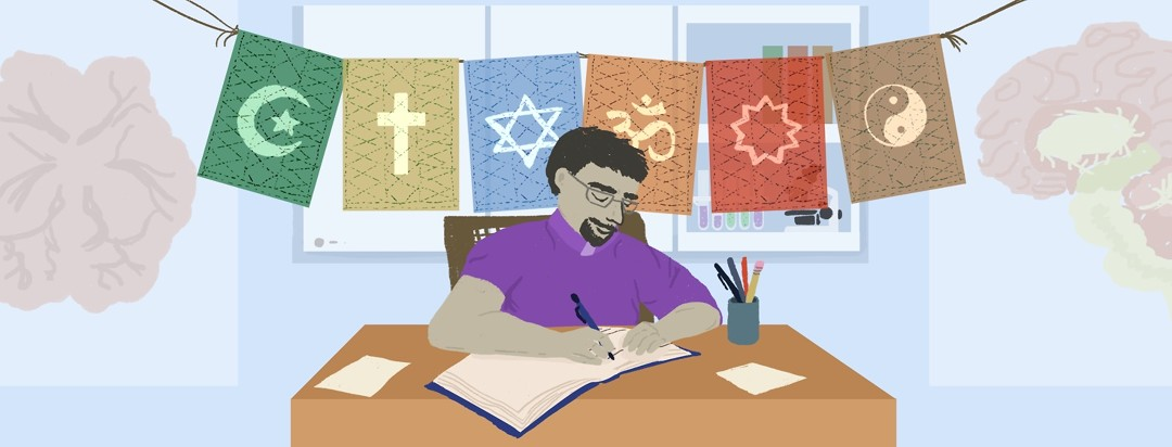 Chaplain writing at a desk in front of prayer flags banner with different religions