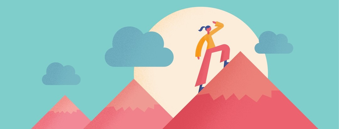 A woman has been climbing many mountains and looks at what's ahead