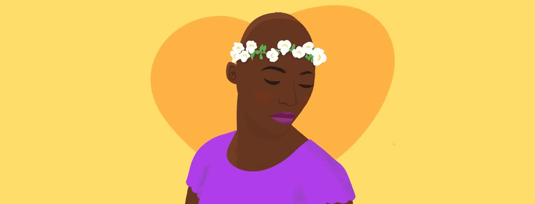 A woman with no hair and a flower crown looks down with a slight smile