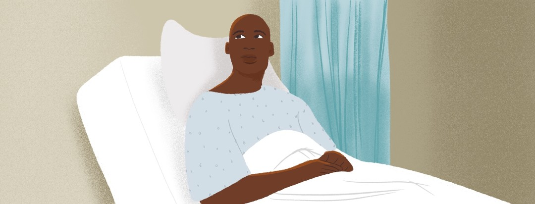 A man in a hospital bed looks up meaningfully