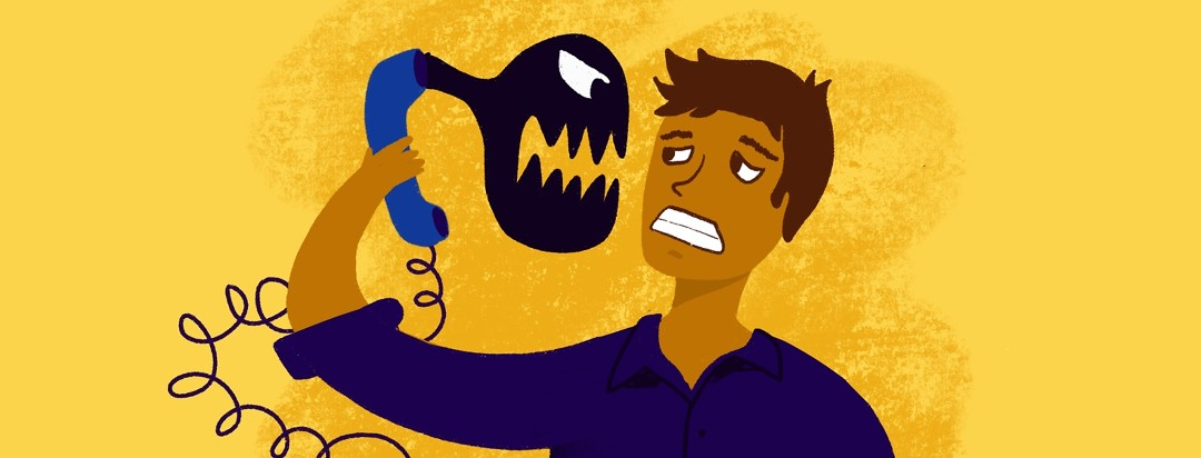 A man holds a phone out at arms length while a monster screams at him through the ear piece