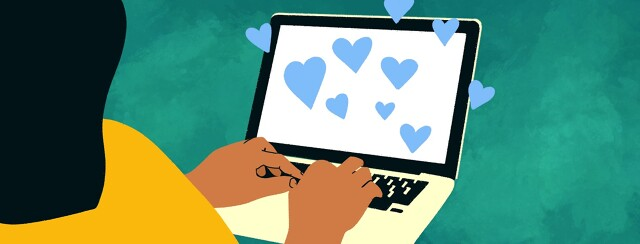A woman types at a computer while hearts fly off the screen