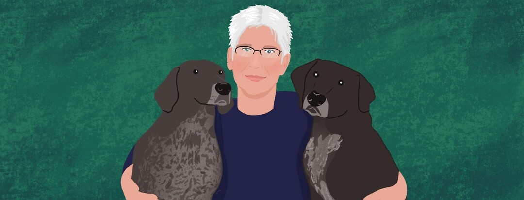 A portrait of community member Kristine Cole and her two dogs