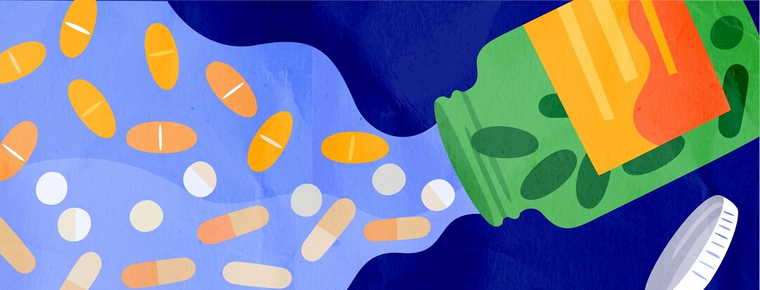Open bottle of vitamins, pills creating a brighter path