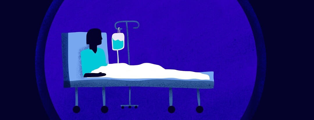 A woman with an IV drip sits in a dark and lonely hospital bed