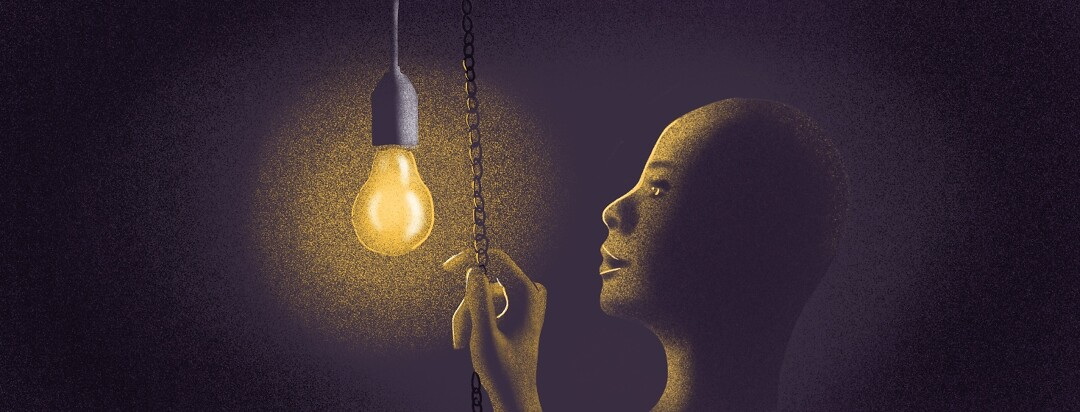 A woman looks at a light in the dark, holding the pull chain