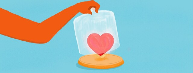 A heart being uncovered by a glass case